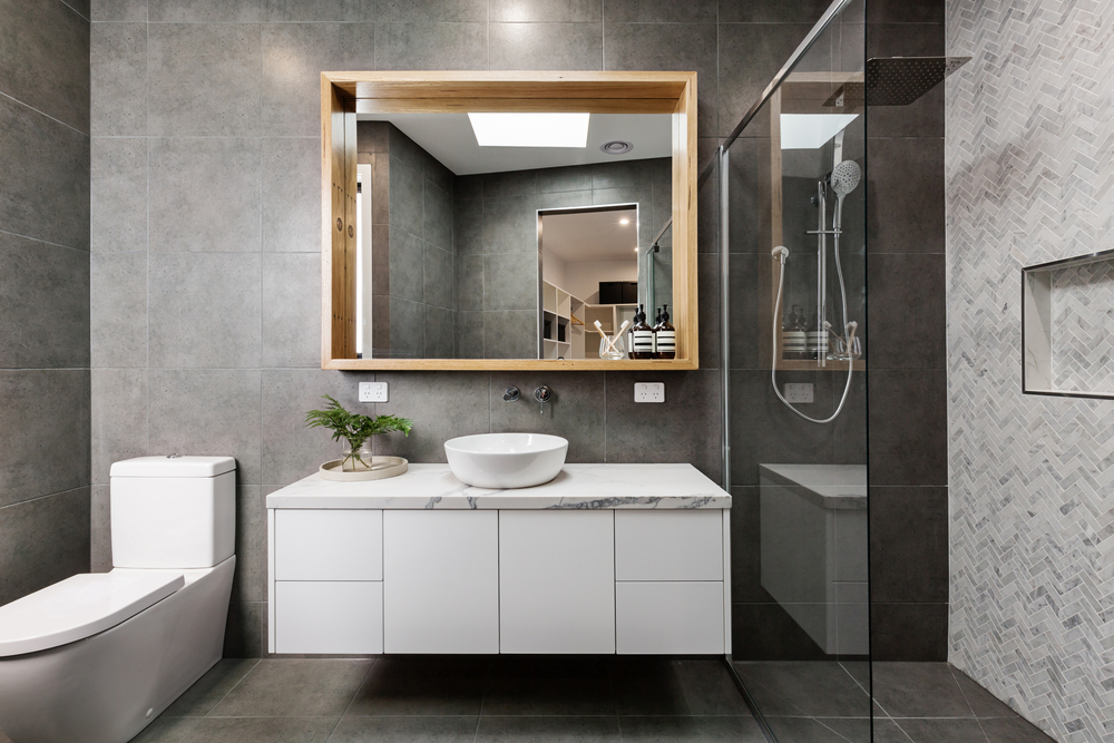 This tiled charcoal bathroom with cedar wood on the floor is one of the best design ideas for the interior of your bathroom. It is stunning.