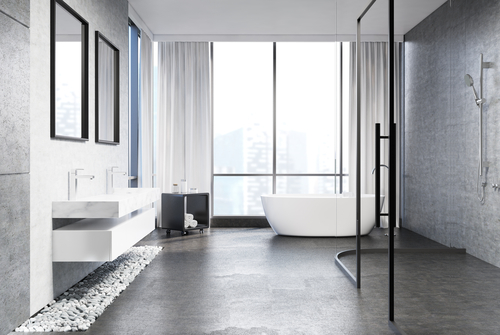 Bathroom with concrete floors and walls