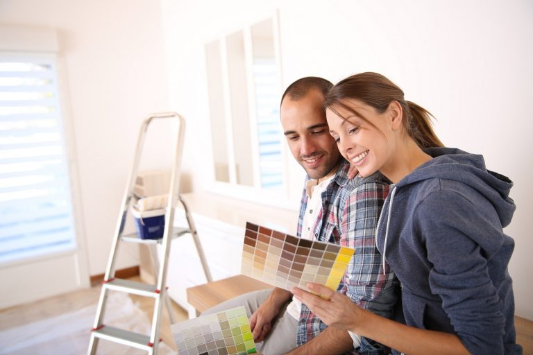 Couple choosing a new house paint color