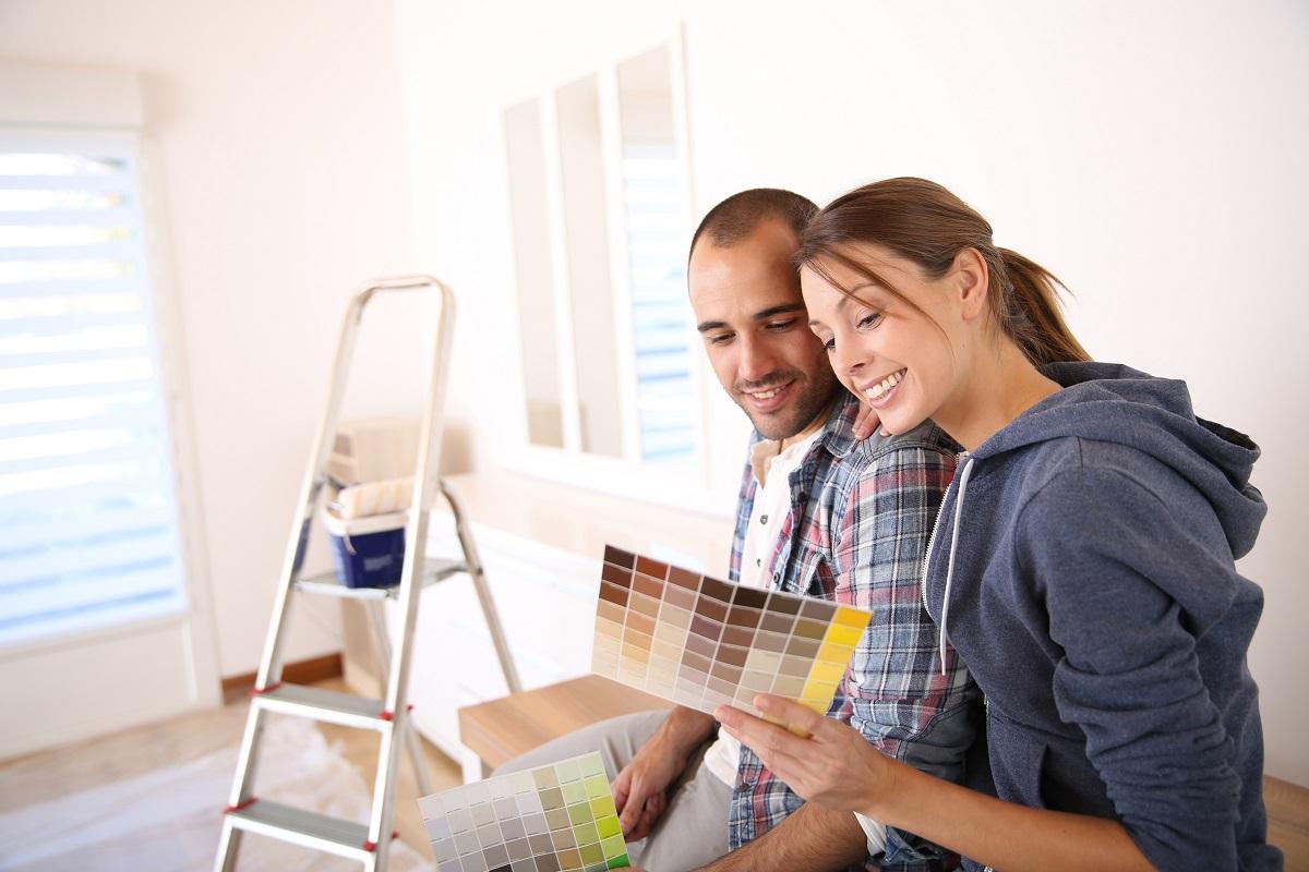 Couple choosing a new house paint color