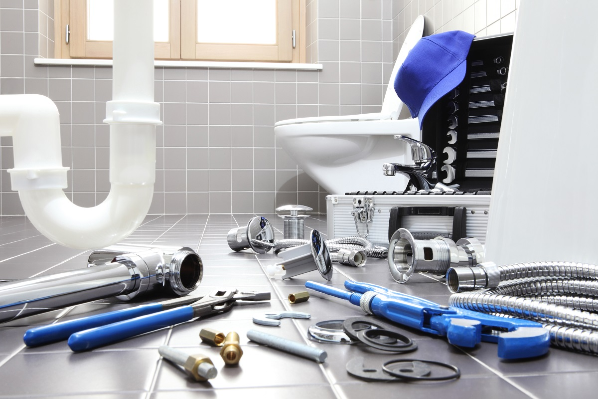 Toilet with repair tools on the floor