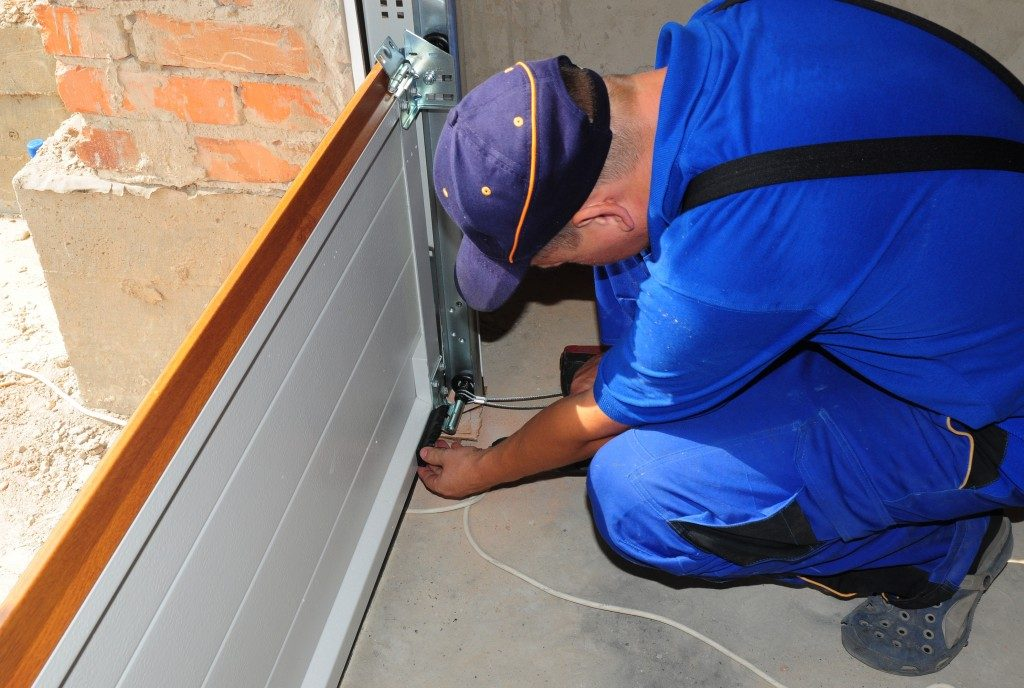 Worker fixing garage door