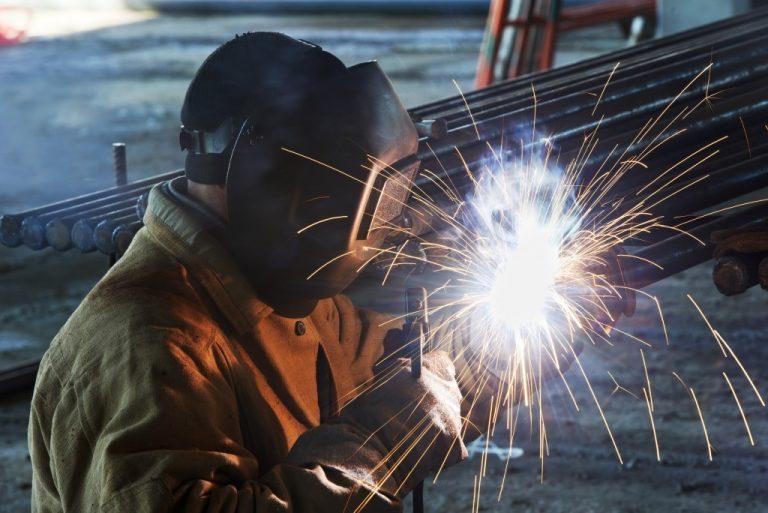 Worker fabricating steel