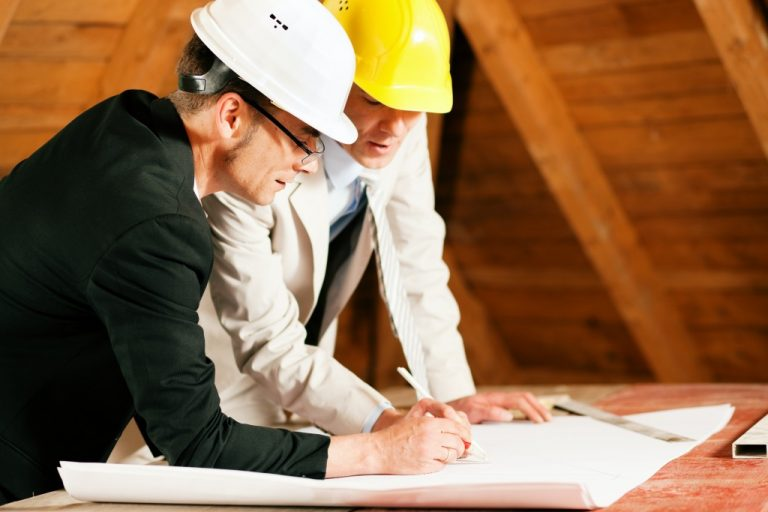 Architect and construction engineer working