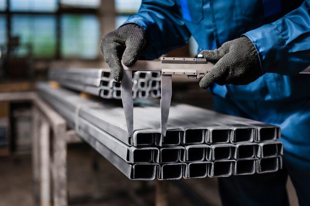 Worker measuring steels