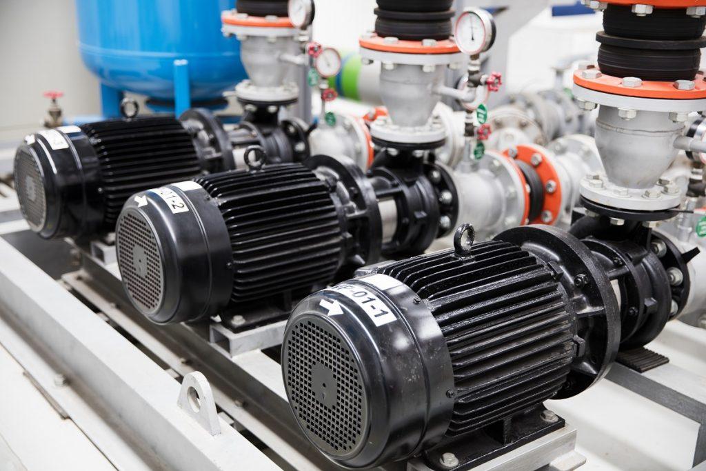 Three black centrifugal pumps