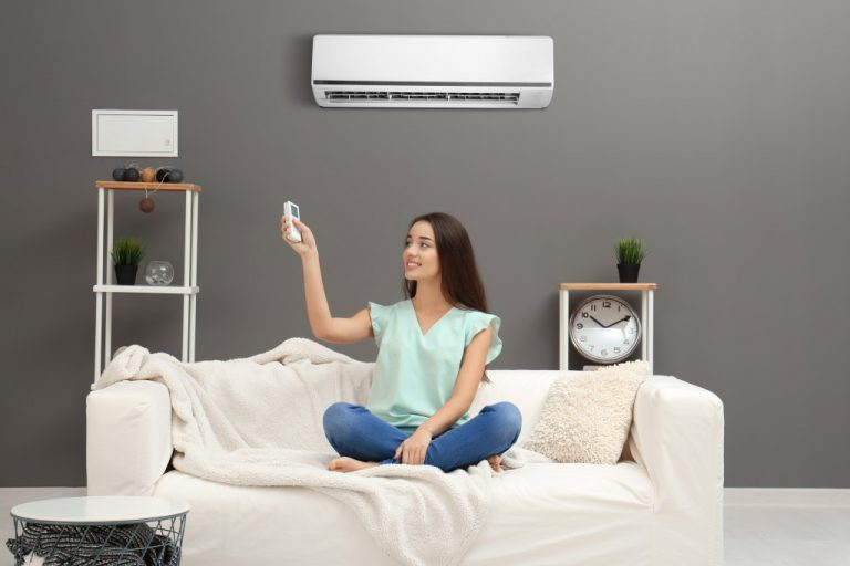 Woman using airconditioning home
