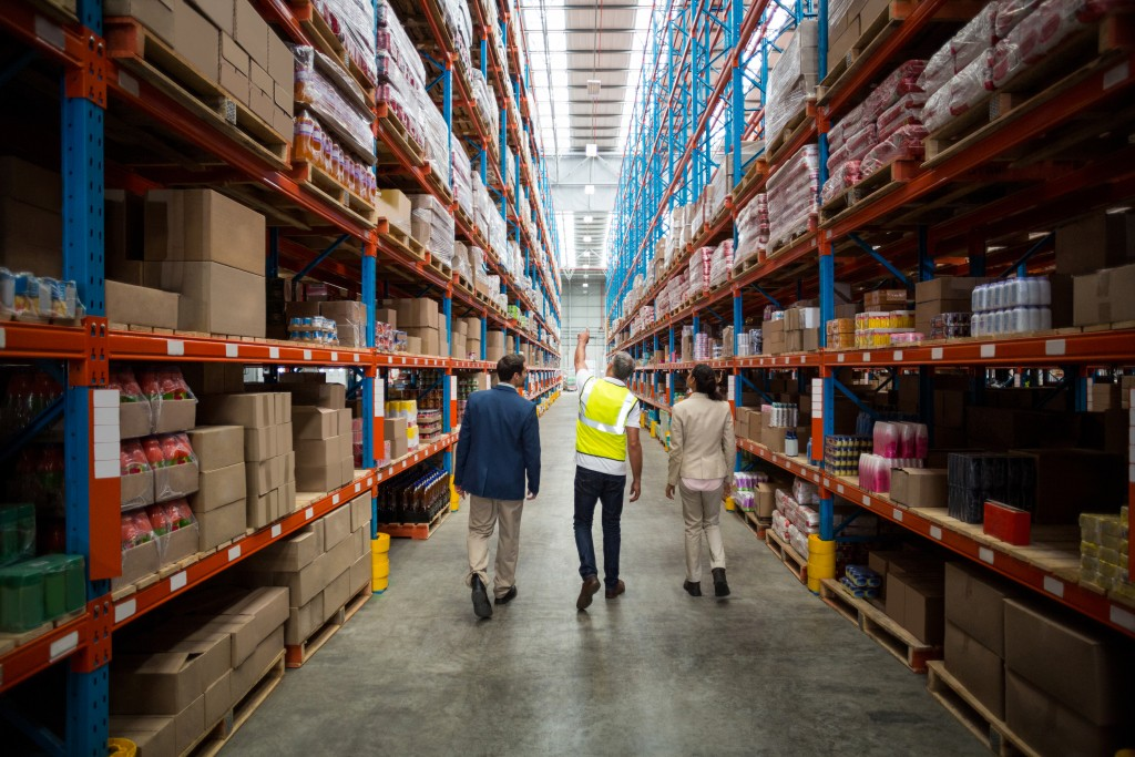 Team discussing while walking in a warehouse