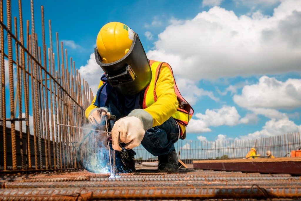 man wearing helmet doing construction