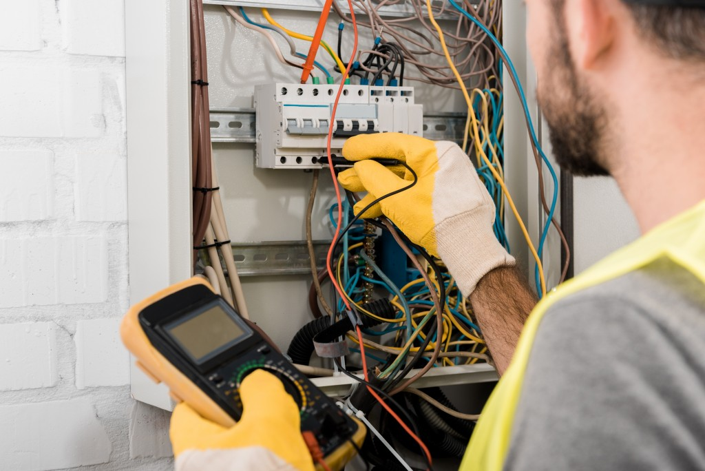 Electrician checking the electric box