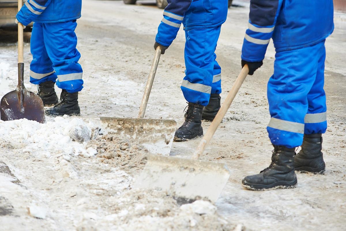 Men shovelling snow