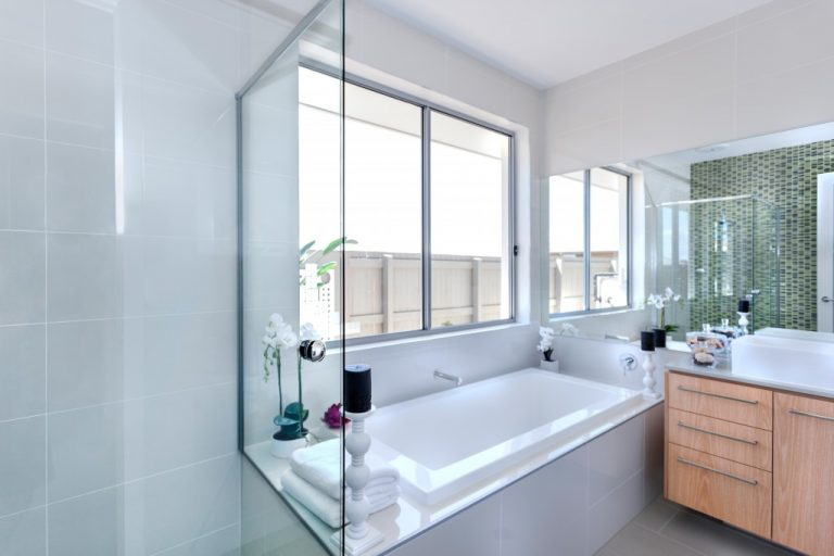 Bathroom with bathtub and large windows