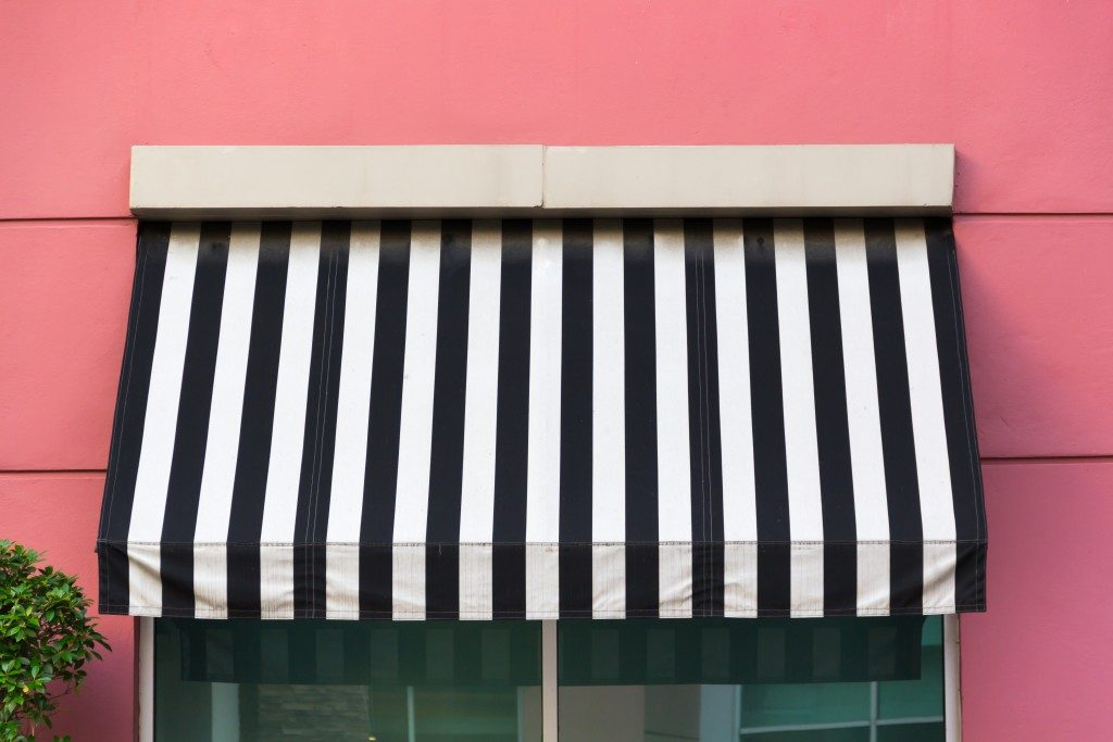 Awning covering a glass window