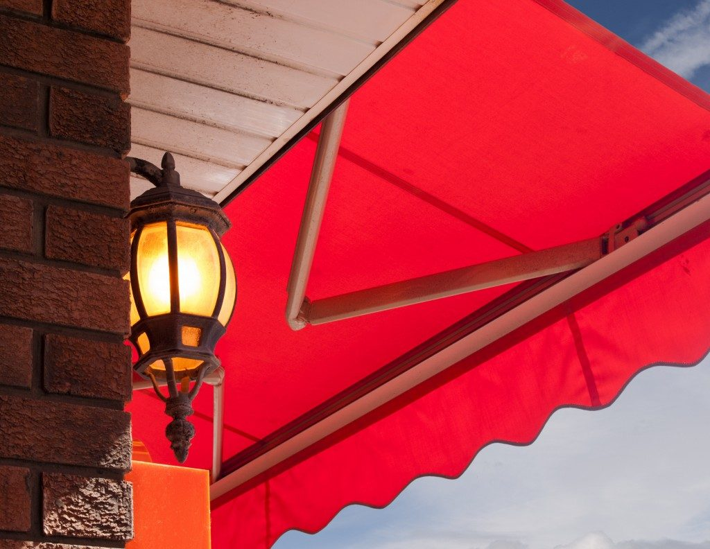 Outdoor light and red awning