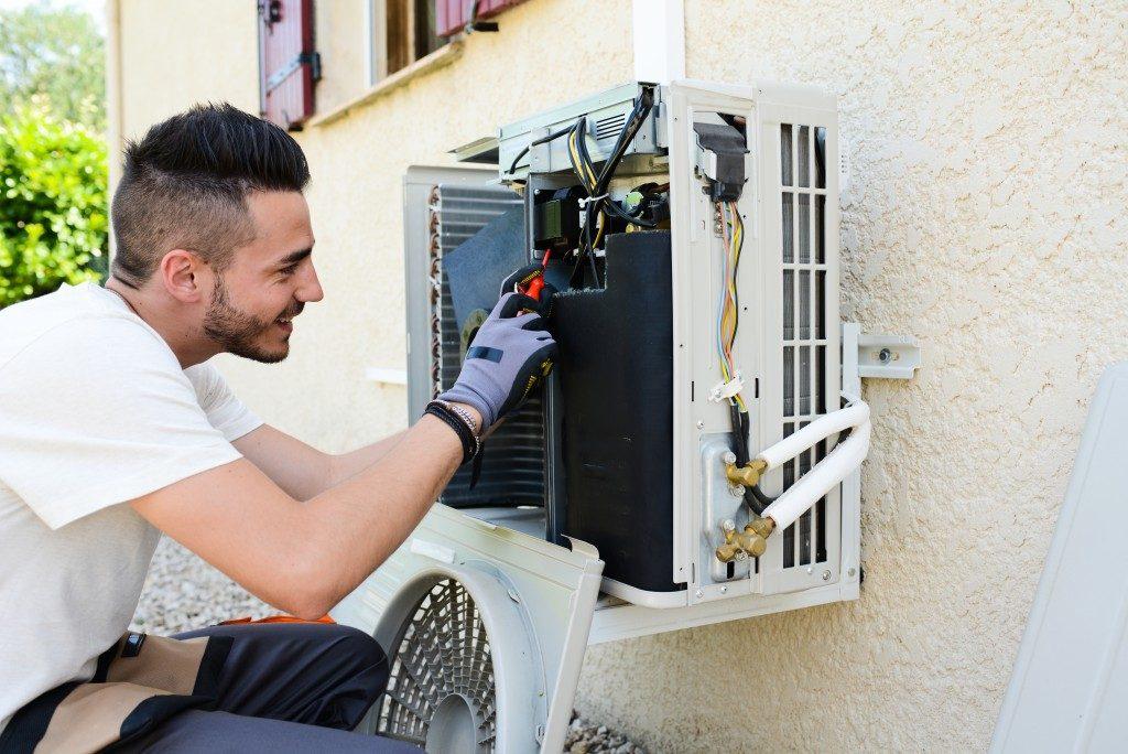 Man Checking Air Conditioner Compressor