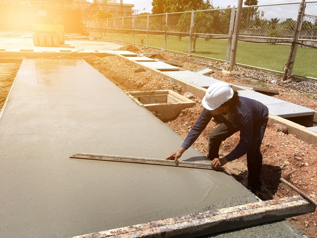 man polishing a concrete slab