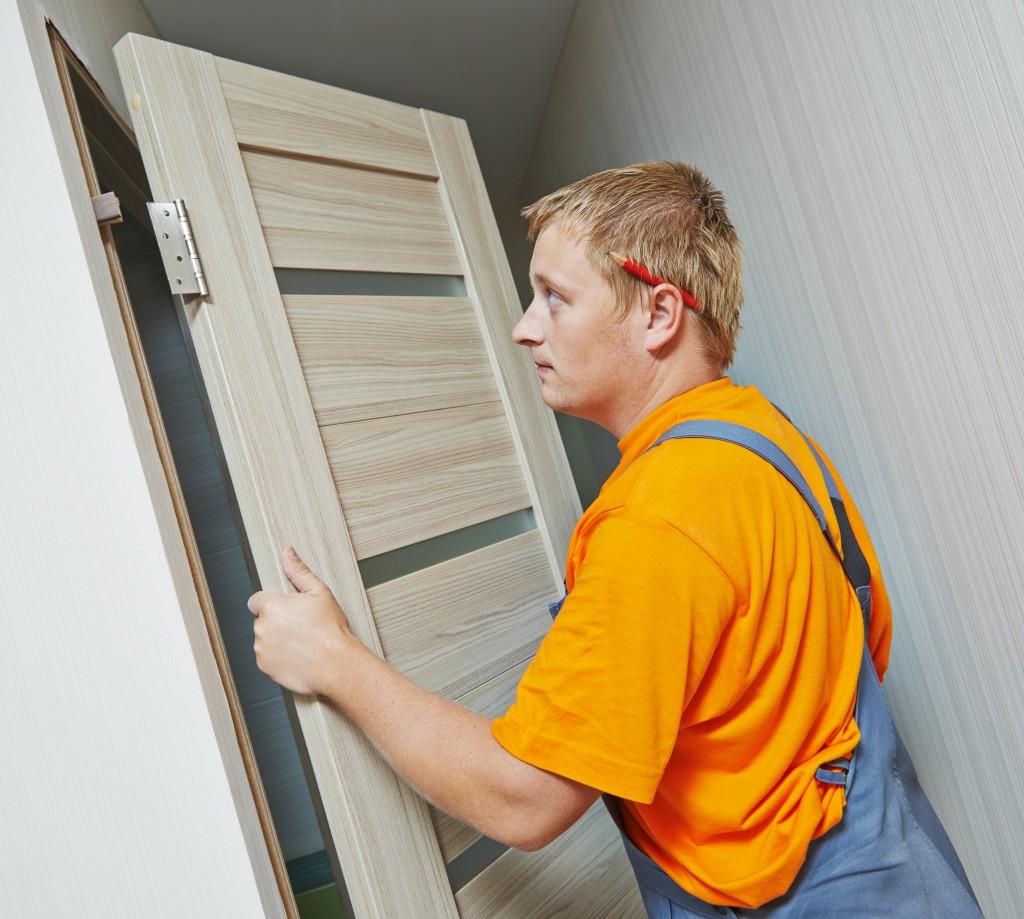 contractor attaching a door