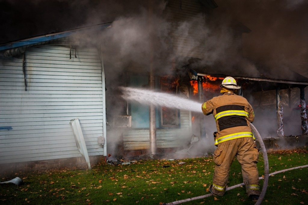 Fireman putting out fire
