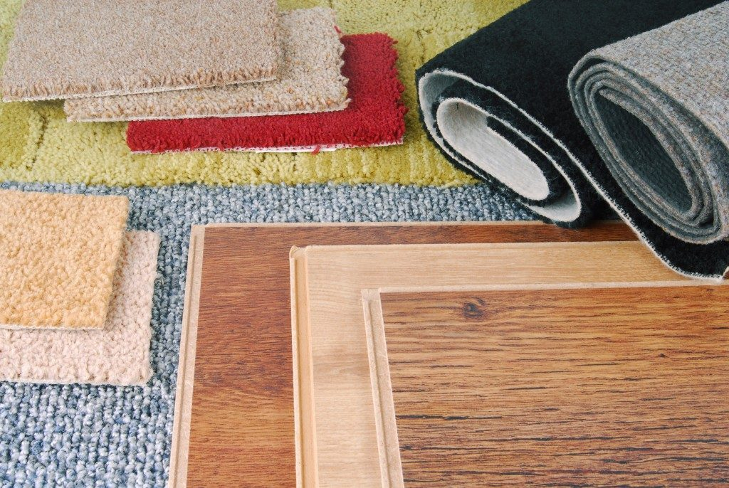 types of timber and carpet samples laid on the floor