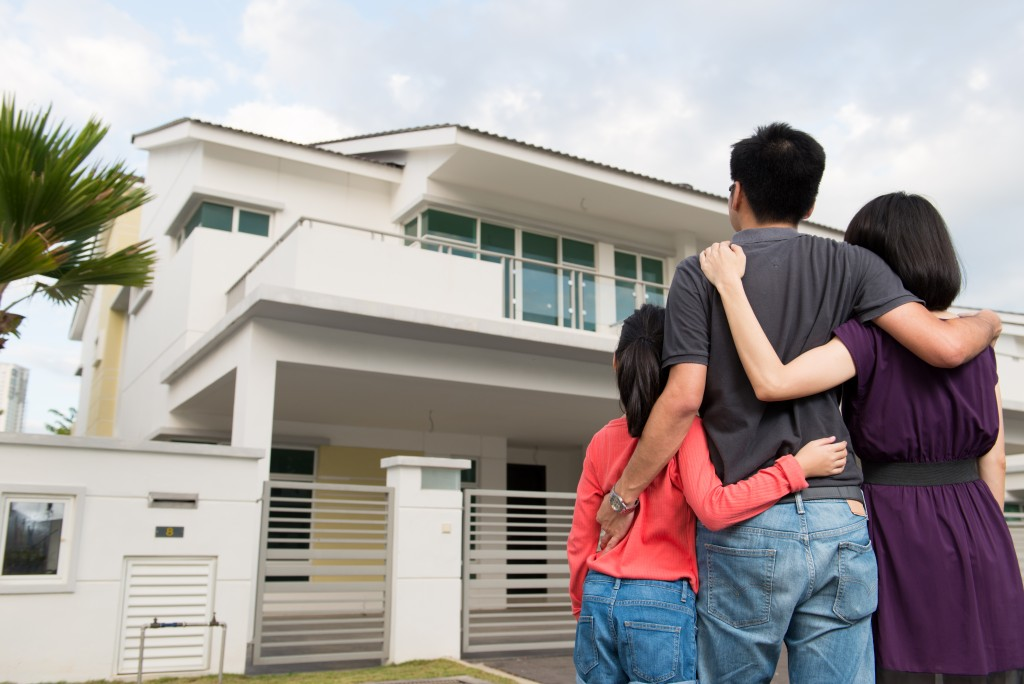 family in front of their dream house