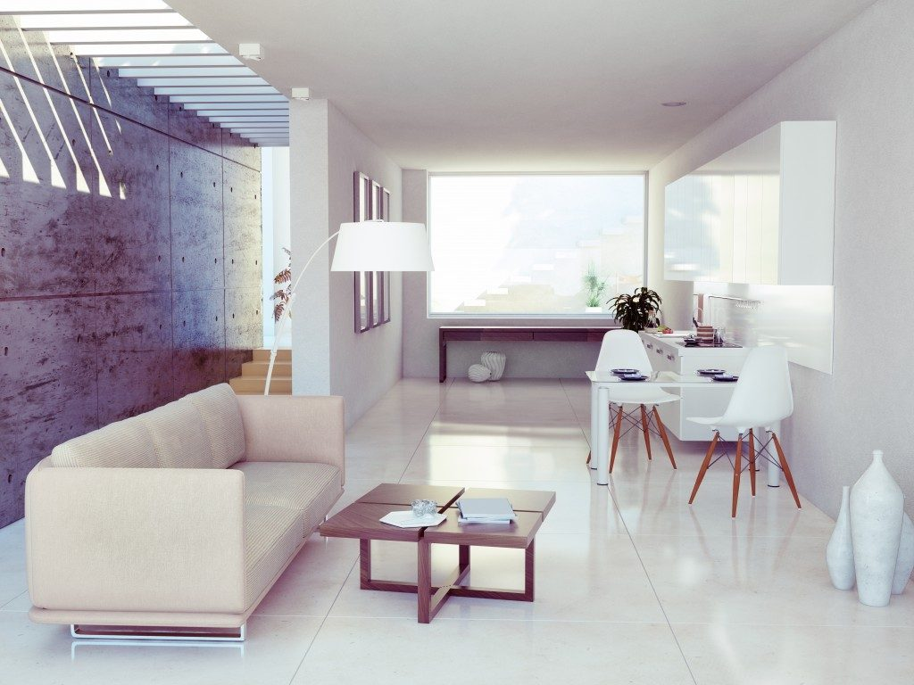 a studio apartment in white and cream colors