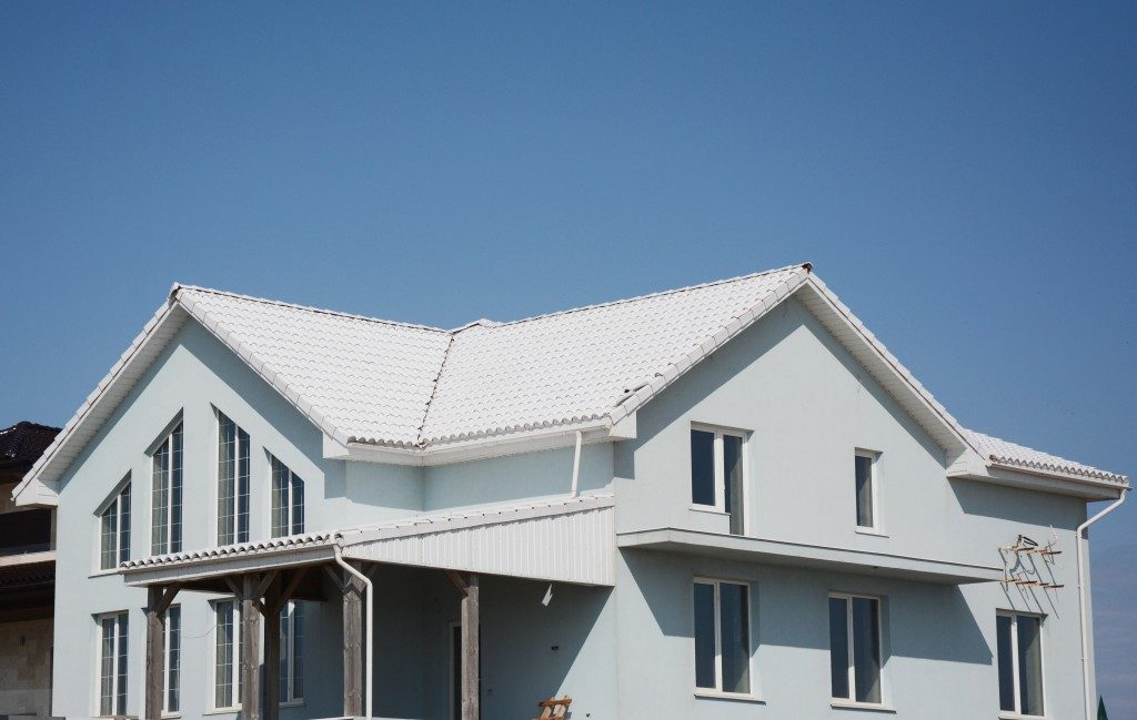 big size house in white colored cool roof