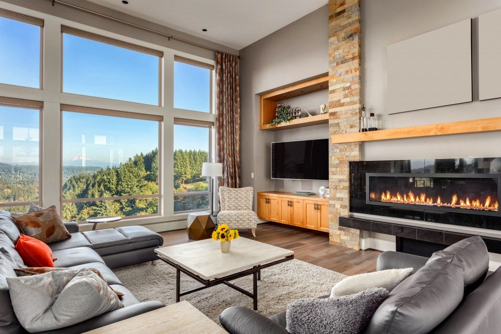 living room with glass windows and a fireplace