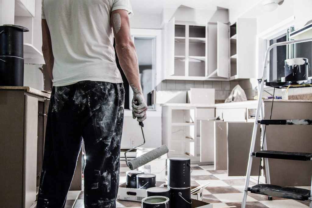 Proffesional painting the newly installed custom kitchen cabinets