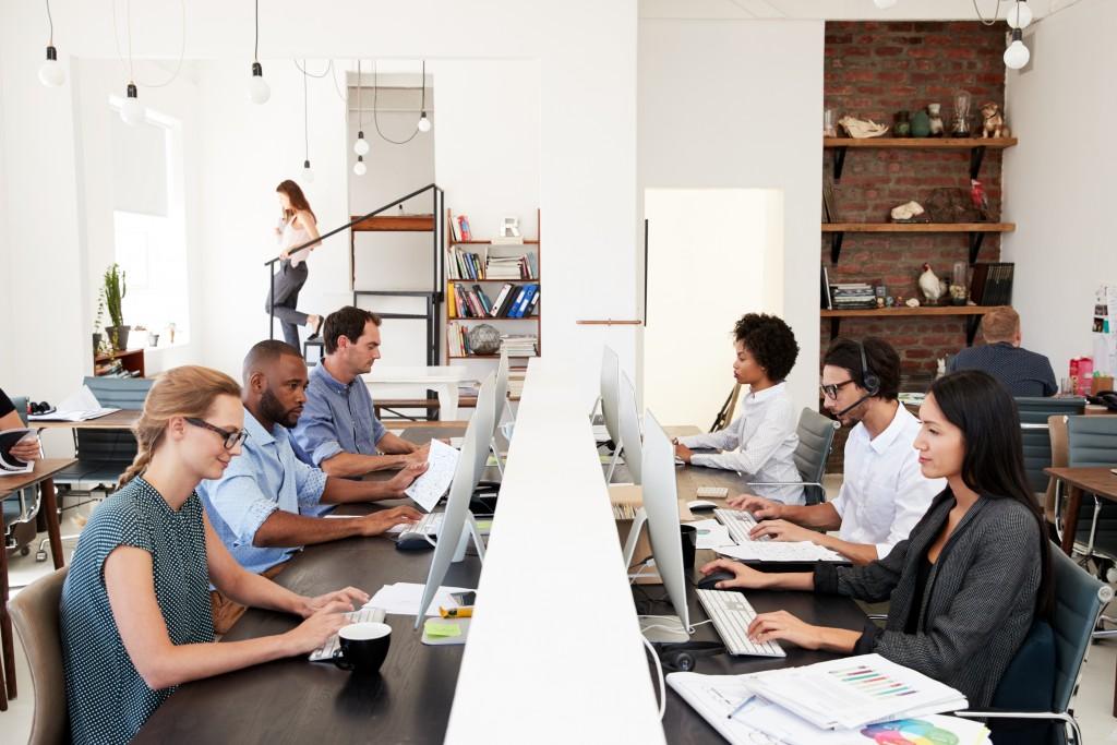Employees working in an open-plan office