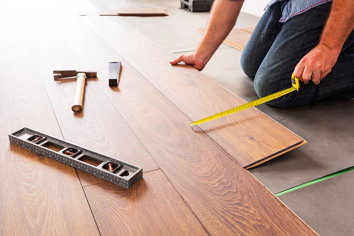 man installing wooden floors