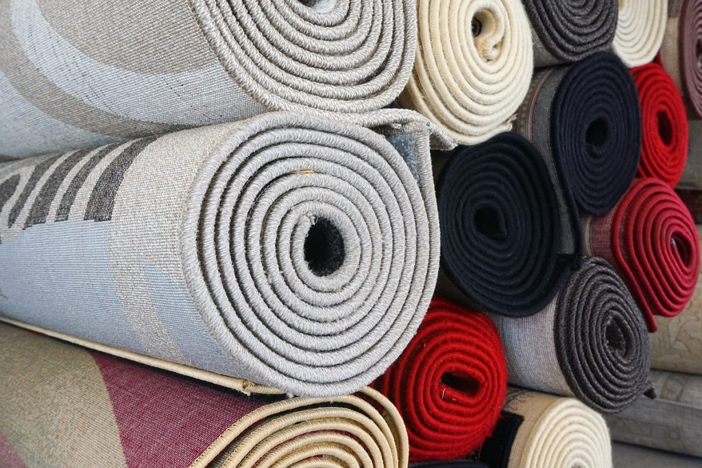 stack of rolled carpets