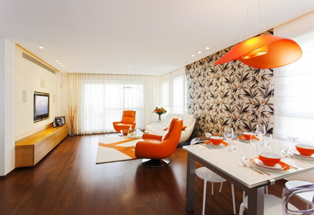 orange furniture and wallpaper on apartment interior