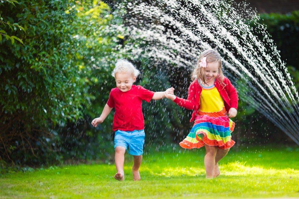kids running in the back yard