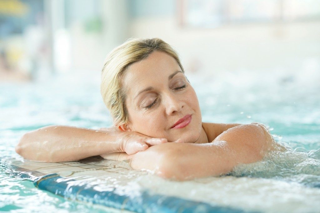 Middle-aged woman enjoying thermal bath