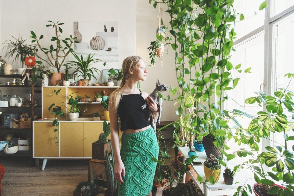 woman in her house full of plants