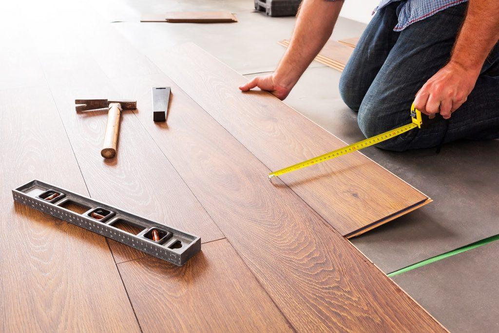 man installing hardwood flooring