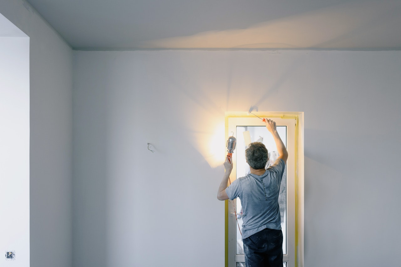 a man installing a door