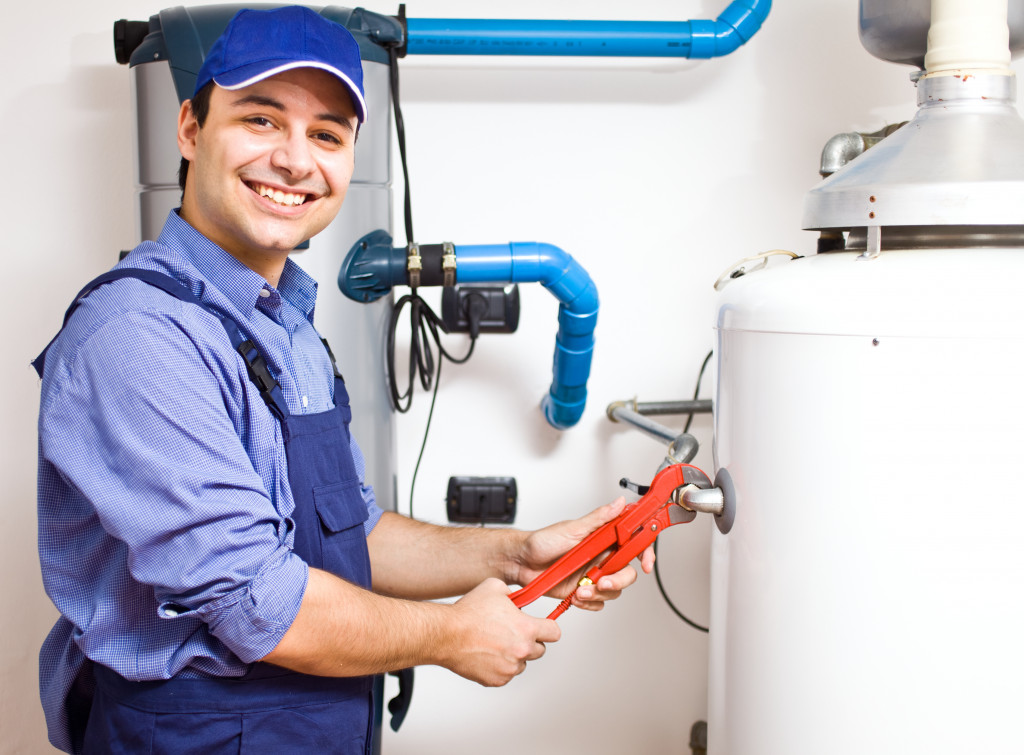 plumber fixing the pipes