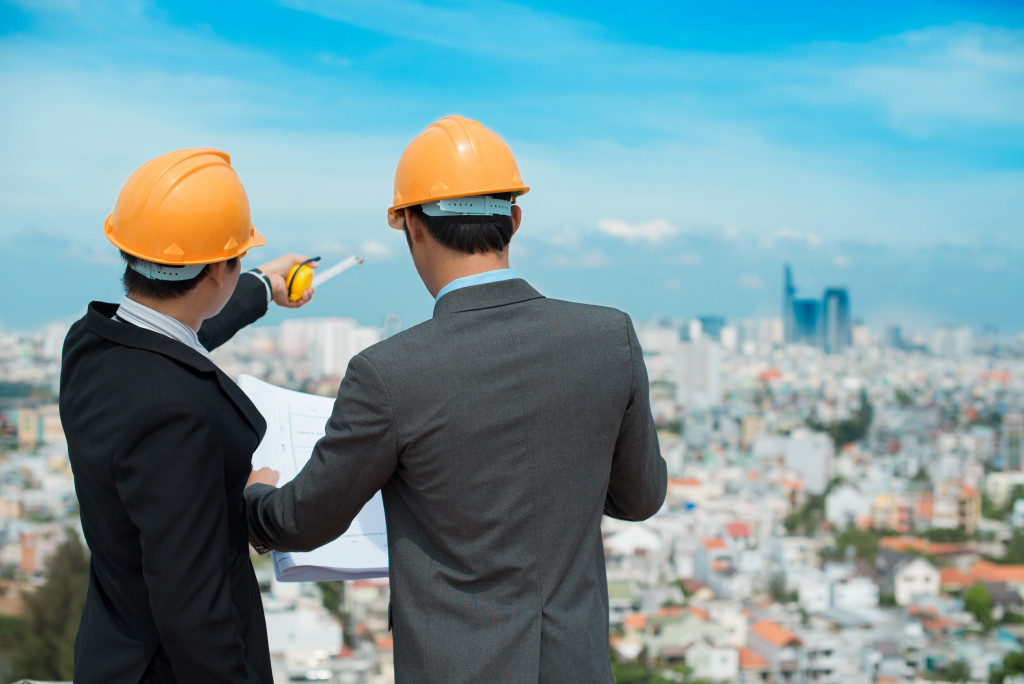 two men with a construction plan